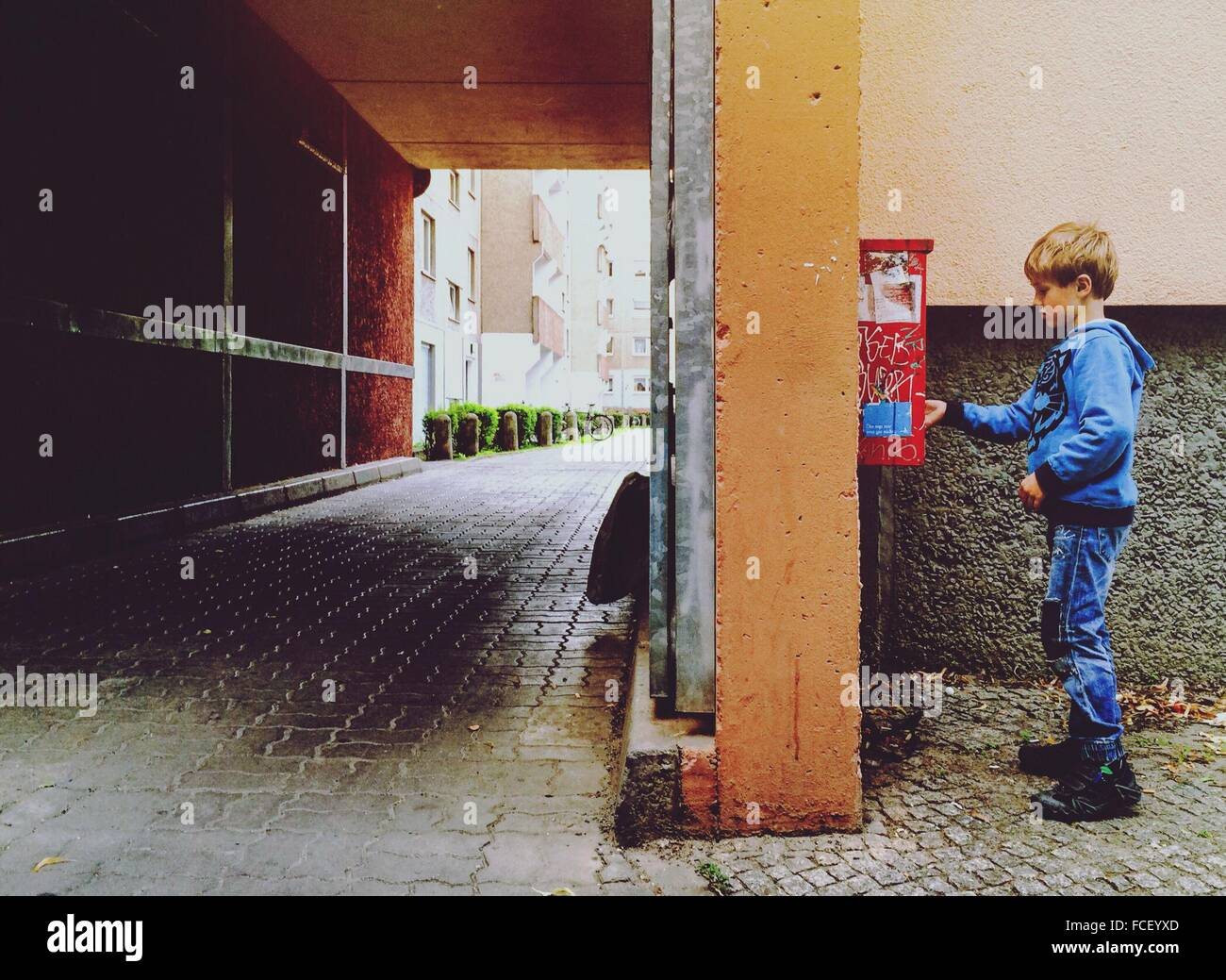 Boy Putting Letter In A Mailbox - Stock Image