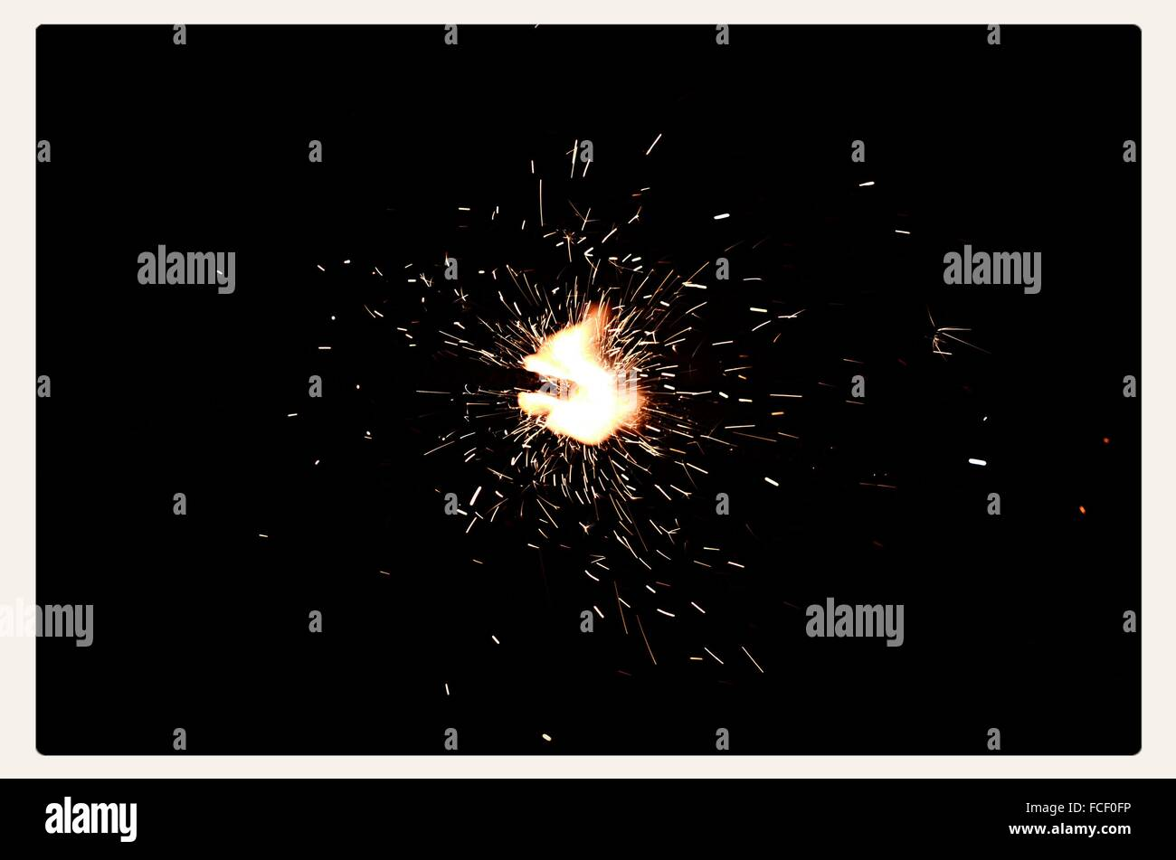 Low Angle View Of Firework Display At Night - Stock Image