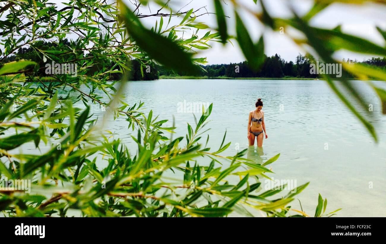 Woman In Swimwear Walking In River - Stock Image