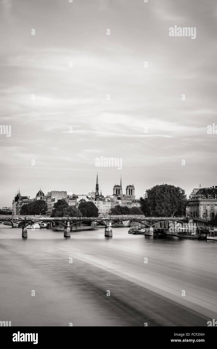 Black & White view of Ile de La Cite and Pont des Arts with the two towers of Notre Dame de Paris Cathedral. - Stock Image
