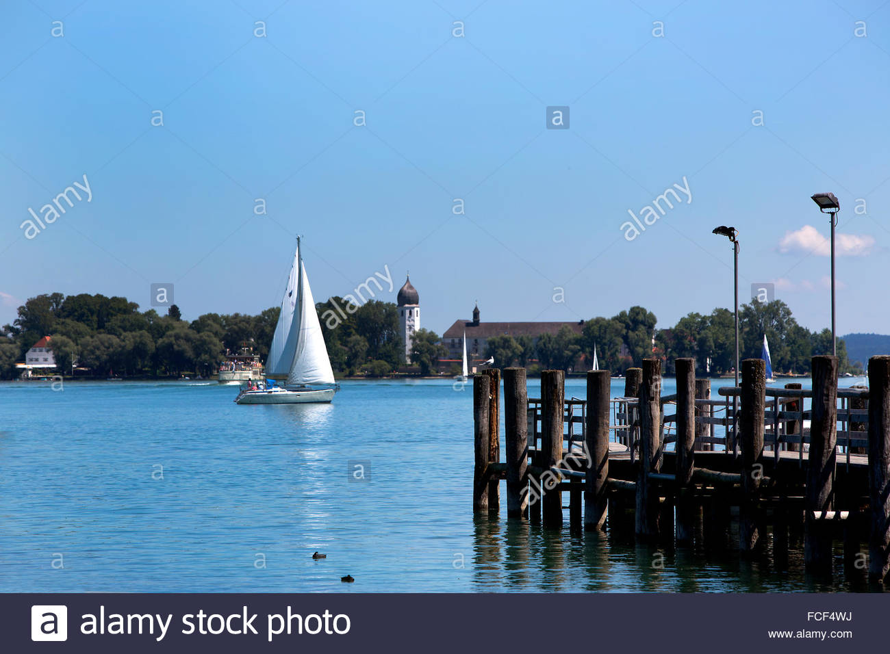 Isle of Frauenchiemsee with sailboats in Bavaria, Germany Stock Photo