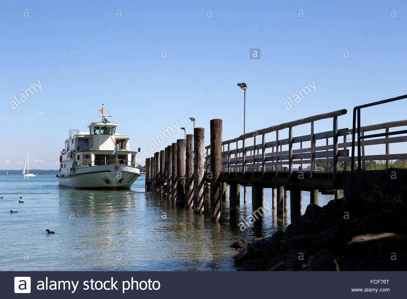 Steamship at the pier at isle Chiemsee in Bavaria, Germany - Stock Image