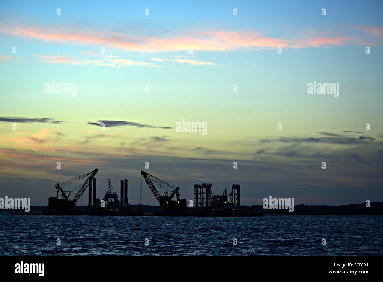View Of Commercial Dock From Sea - Stock Image