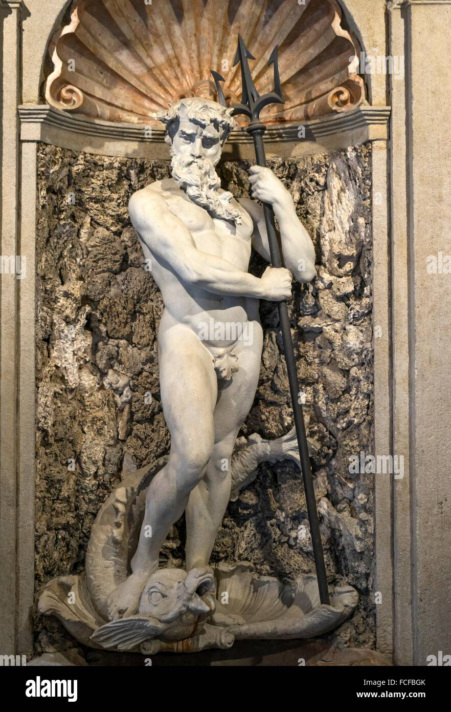 Classical statue of the god Poseidon in the court of an old palace downtown Milan, Lombardy, Italy - Stock Image
