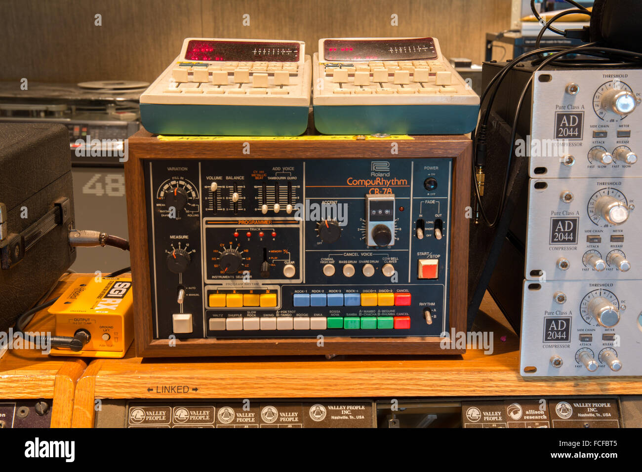Roland compurhythm cr-78 drum machine on top of an effects rack in a recording studio - Stock Image
