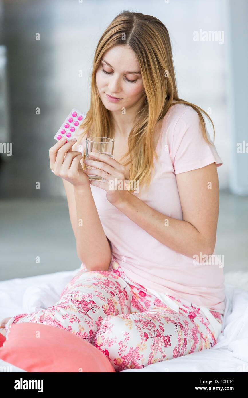 Woman taking medicines. - Stock Image
