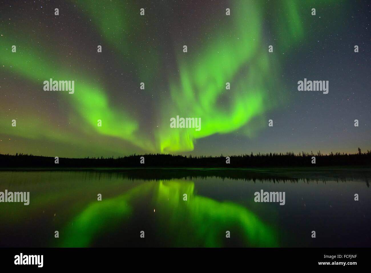 Aurora borealis over Prosperous Lake, Yellowknife, Northwest Territories, Canada. - Stock Image