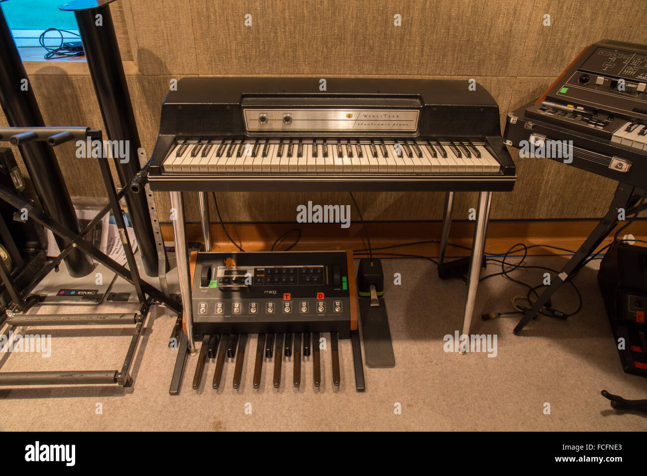 wurlitzer ep 200a electric piano with moog taurus 3 bass pedal synthesizer underneath taken in a recording studio - Stock Image