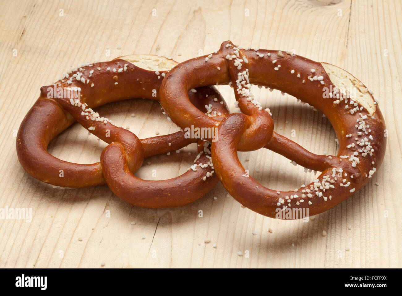 Two fresh soft pretzels with salt - Stock Image