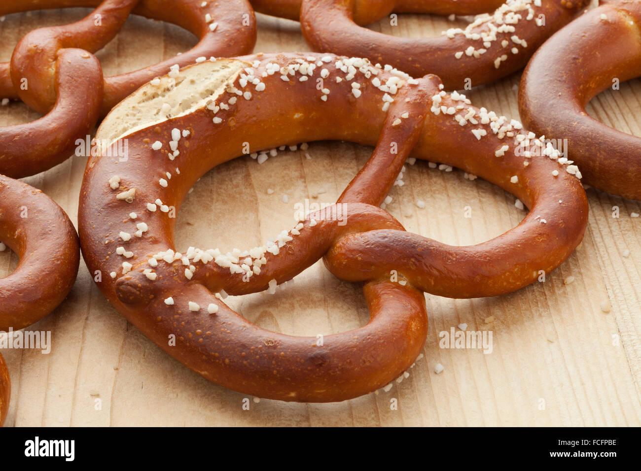 Fresh soft pretzels with salt - Stock Image