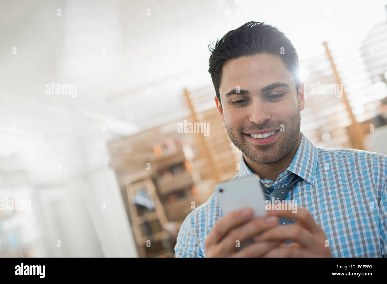 A man checking his smart phone. - Stock Image