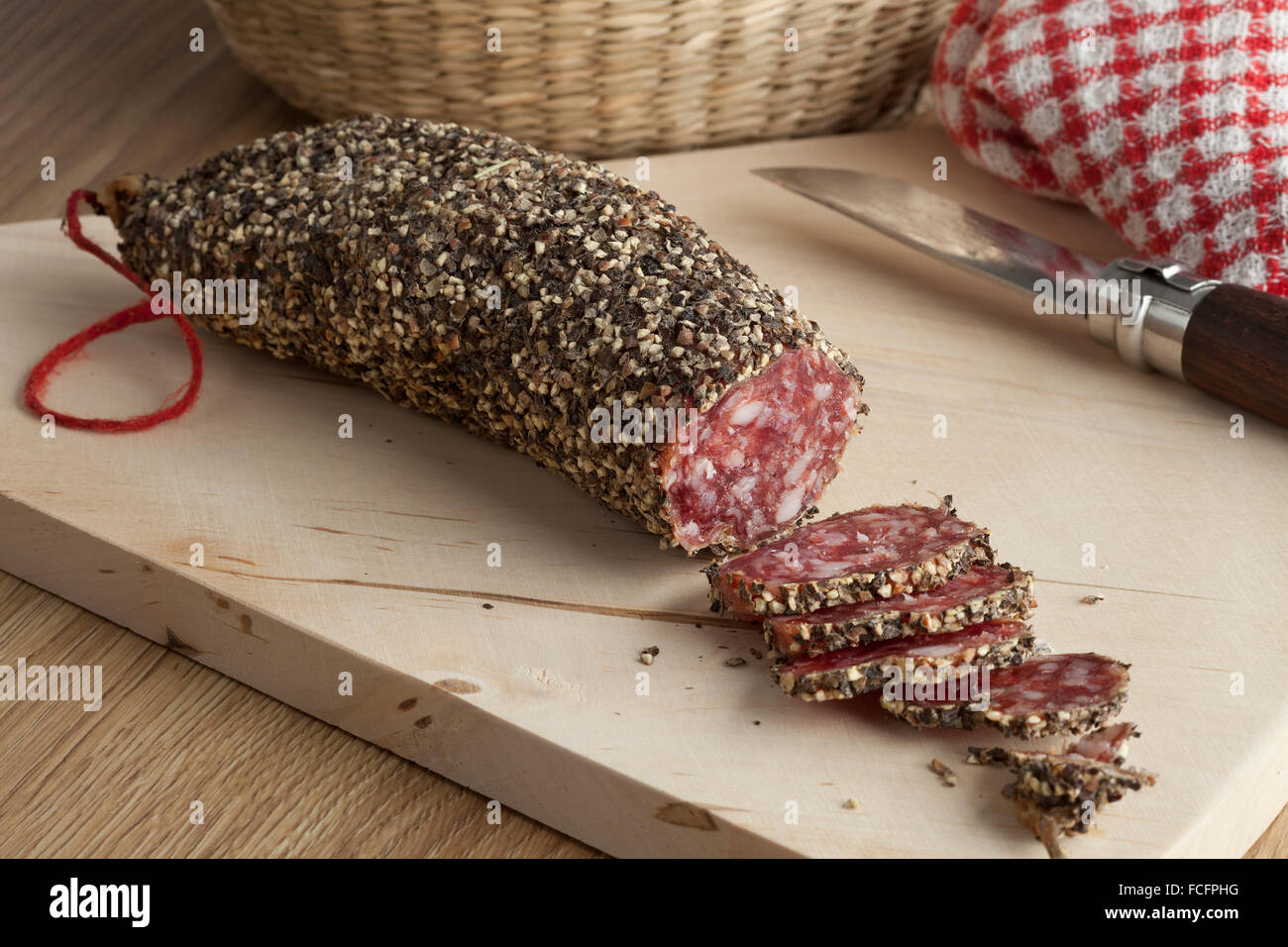 French sausage covered with black and white pepper - Stock Image
