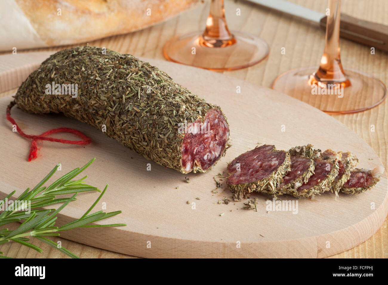 French sausage covered with dried rosemary - Stock Image