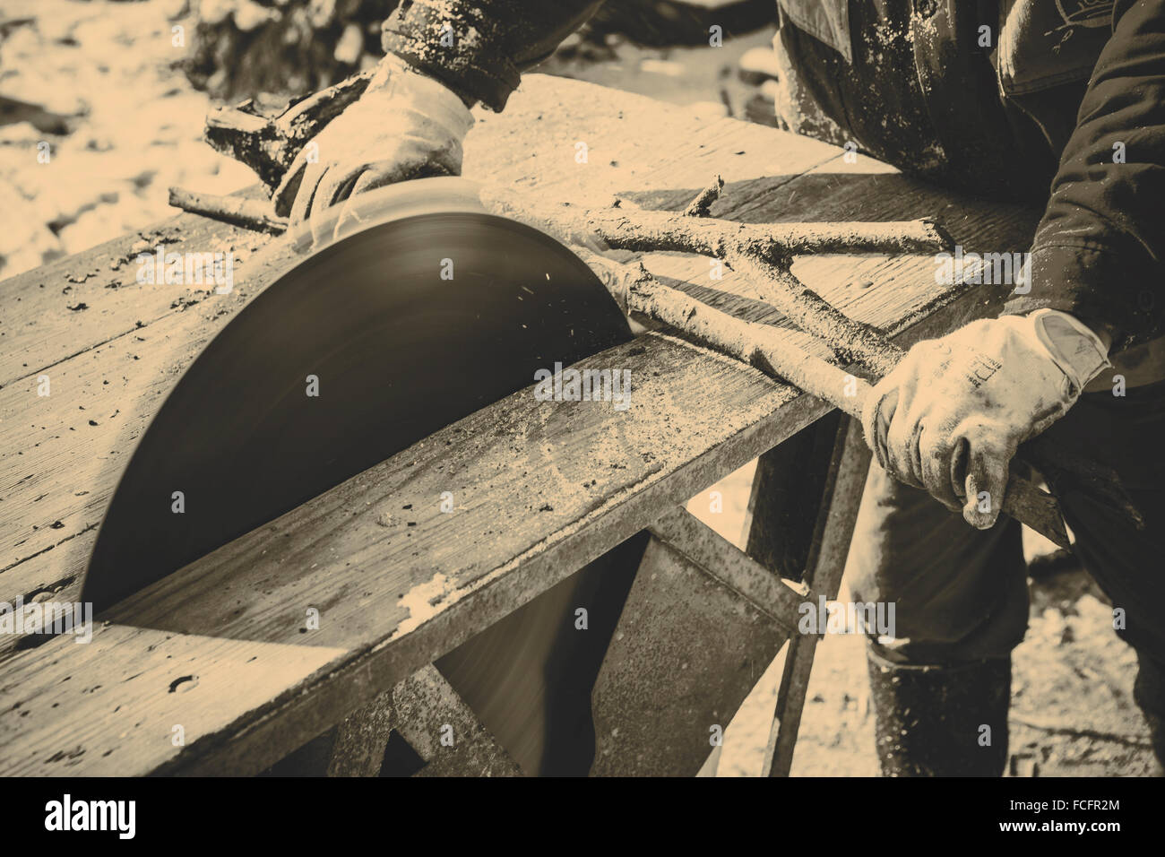 Man working with old handmade circular saw blade - Stock Image