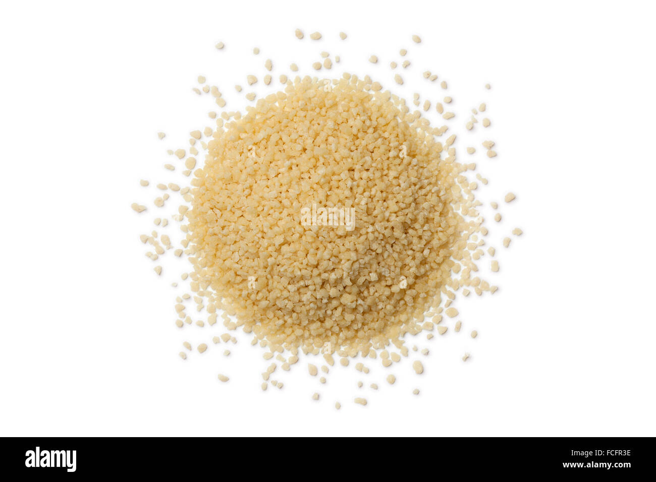 Heap of raw couscous grains on white background - Stock Image