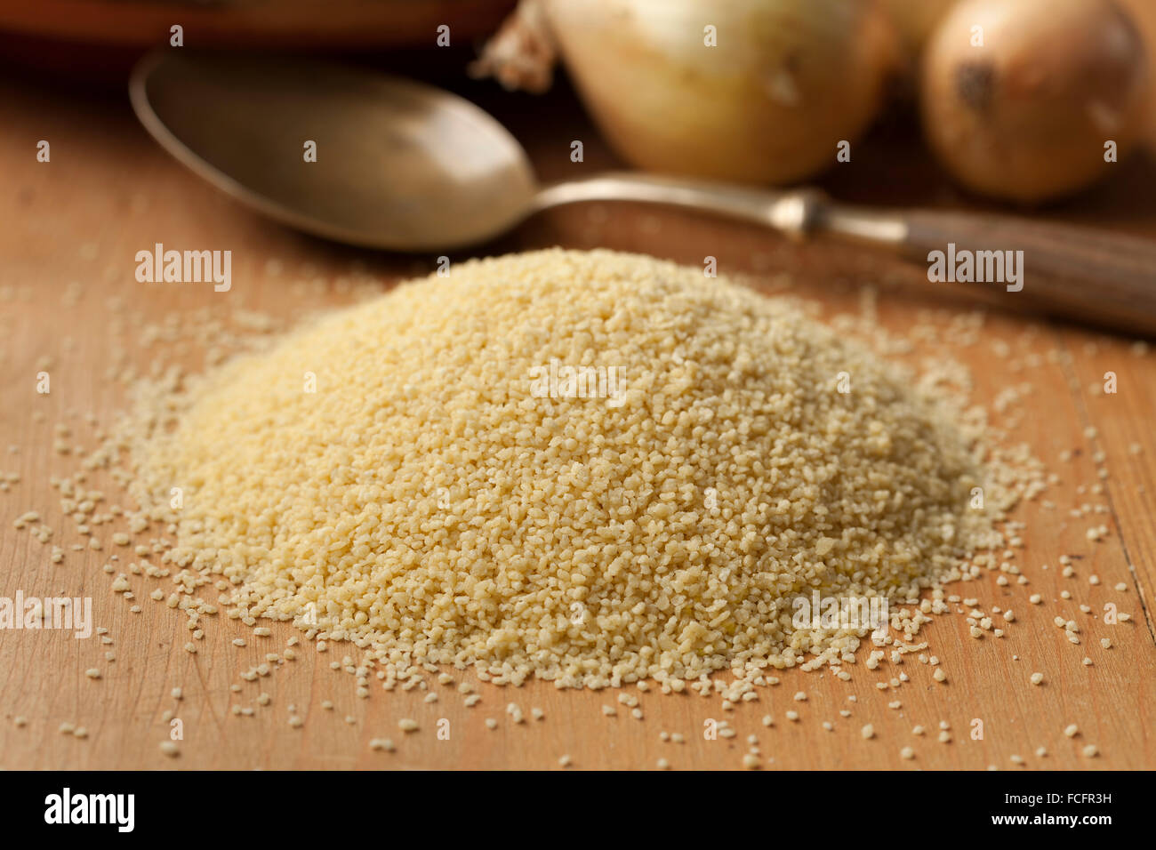 Raw couscous grains, popular food in North African countries - Stock Image
