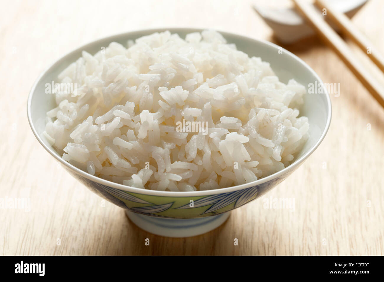 Bowl with cooked white Jasmine rice - Stock Image