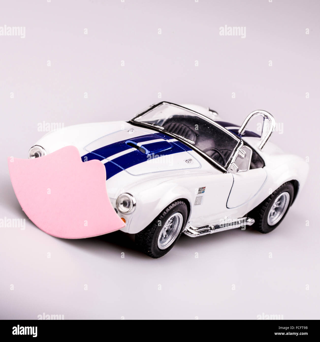 beautiful blue and white car, roadster with pink kiss, valentine car - Stock Image