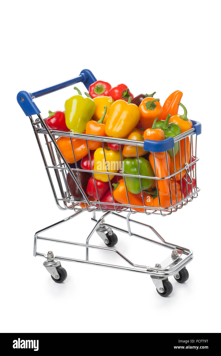 Shopping trolley filled with colorful vine sweet mini peppers on white background - Stock Image