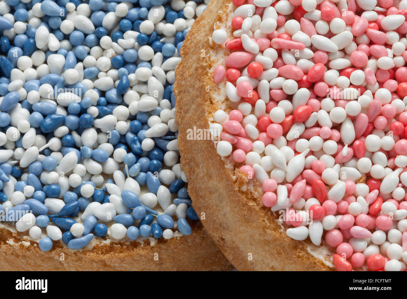 'Beschuit met muisjes, a traditional treat to celebrate the birth of a child in The Netherlands. Pink  sprinkles - Stock Image