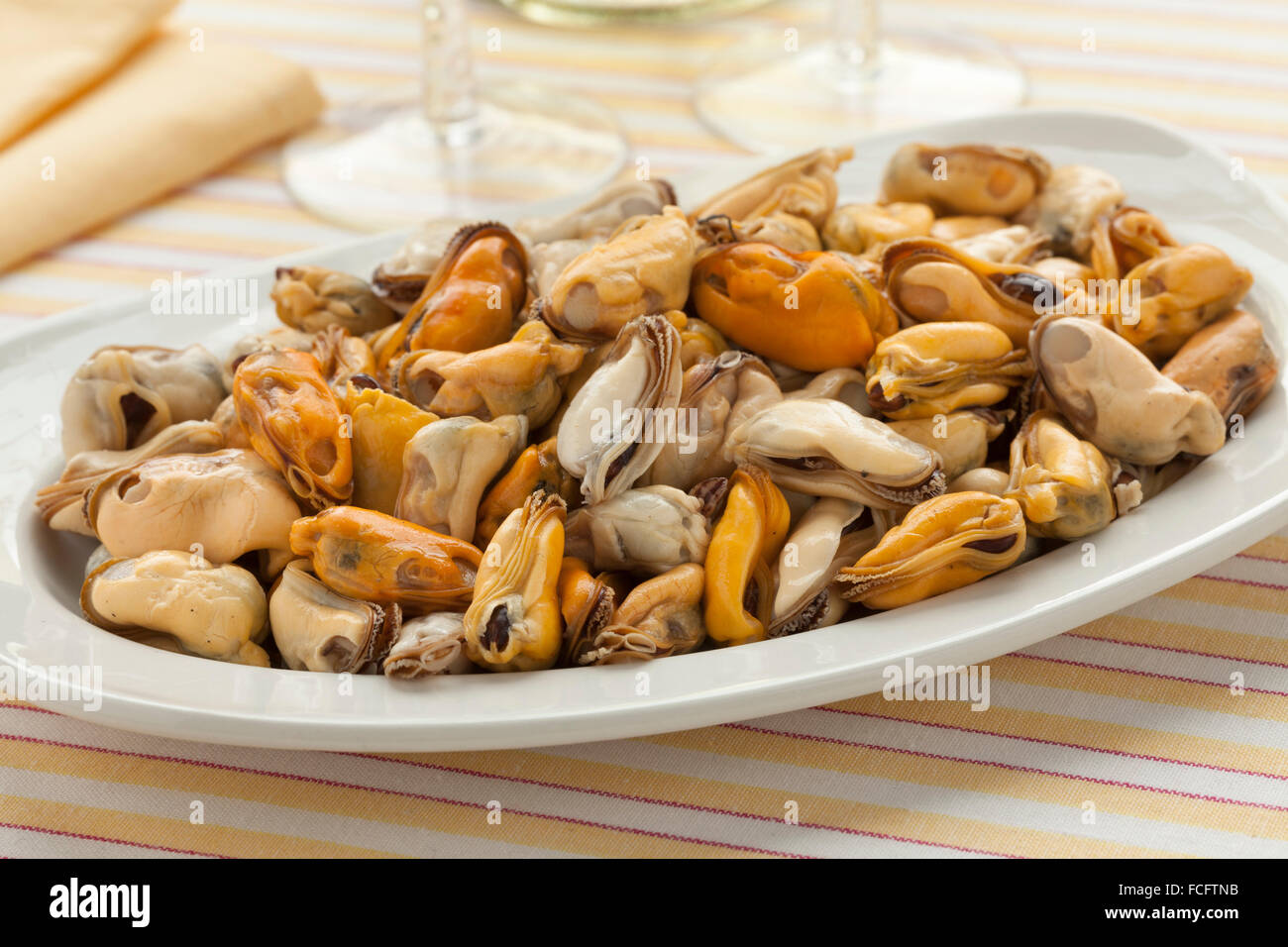 Dish with fresh cooked mussels ready to eat - Stock Image