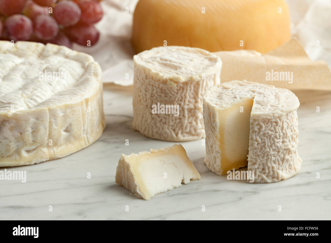 French cheese platter with camembert,goats cheese and grapes as dessert - Stock Image