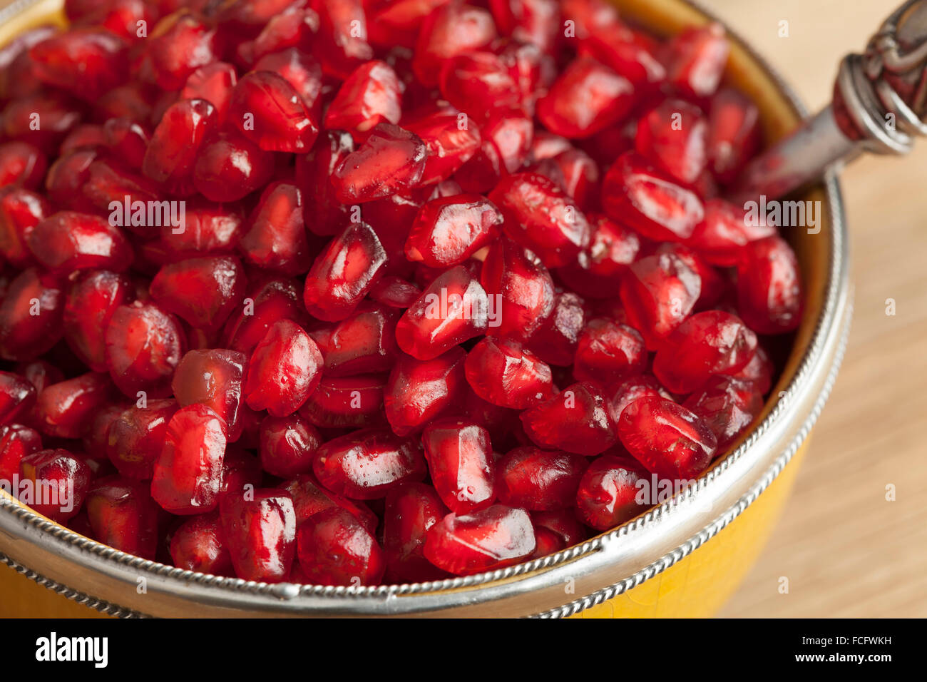 Moroccan dessert from fresh red pomegranate seeds close up - Stock Image