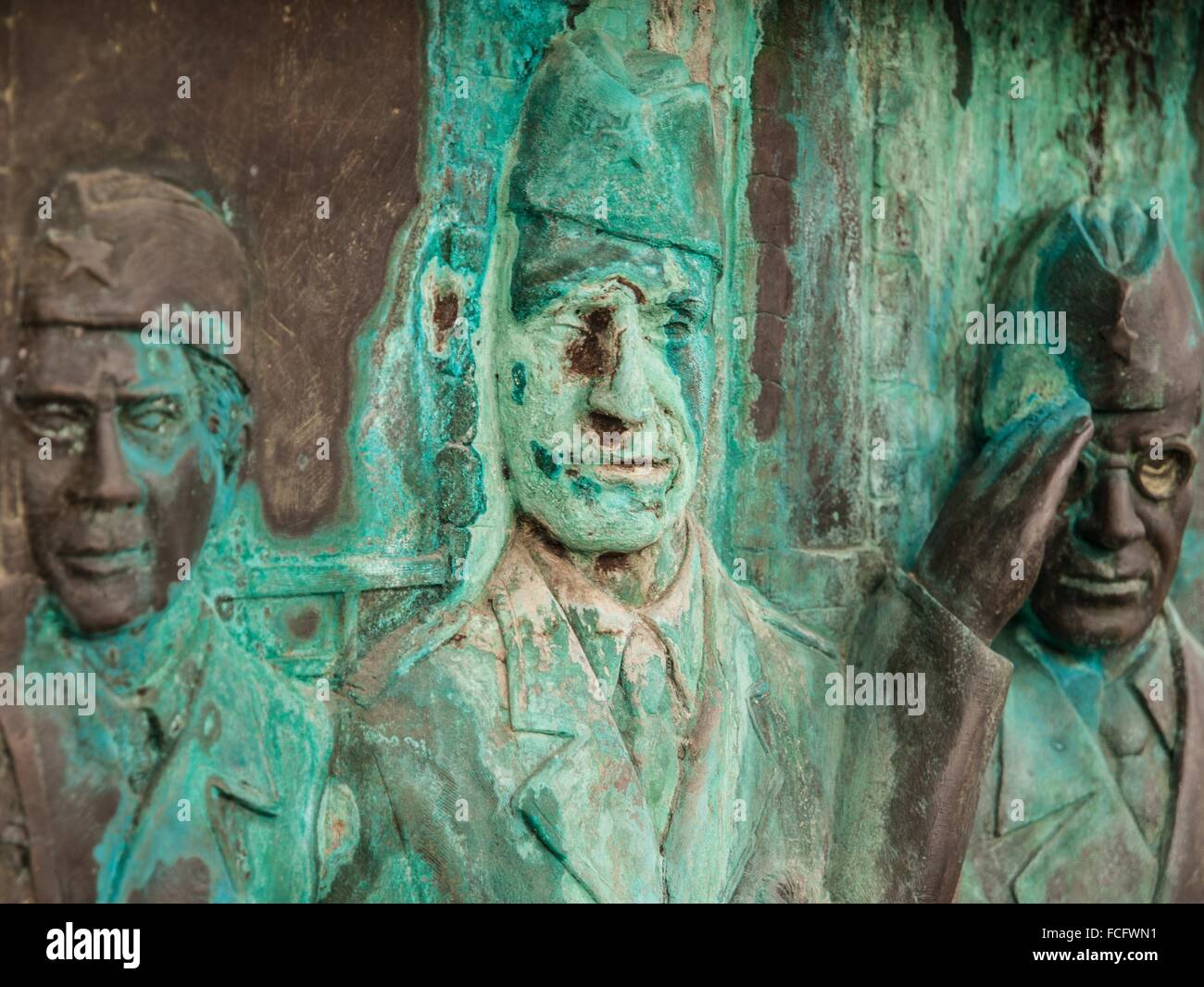 Oxidized carving of three army veterans in Skopje, Macedonia, Europe. - Stock Image