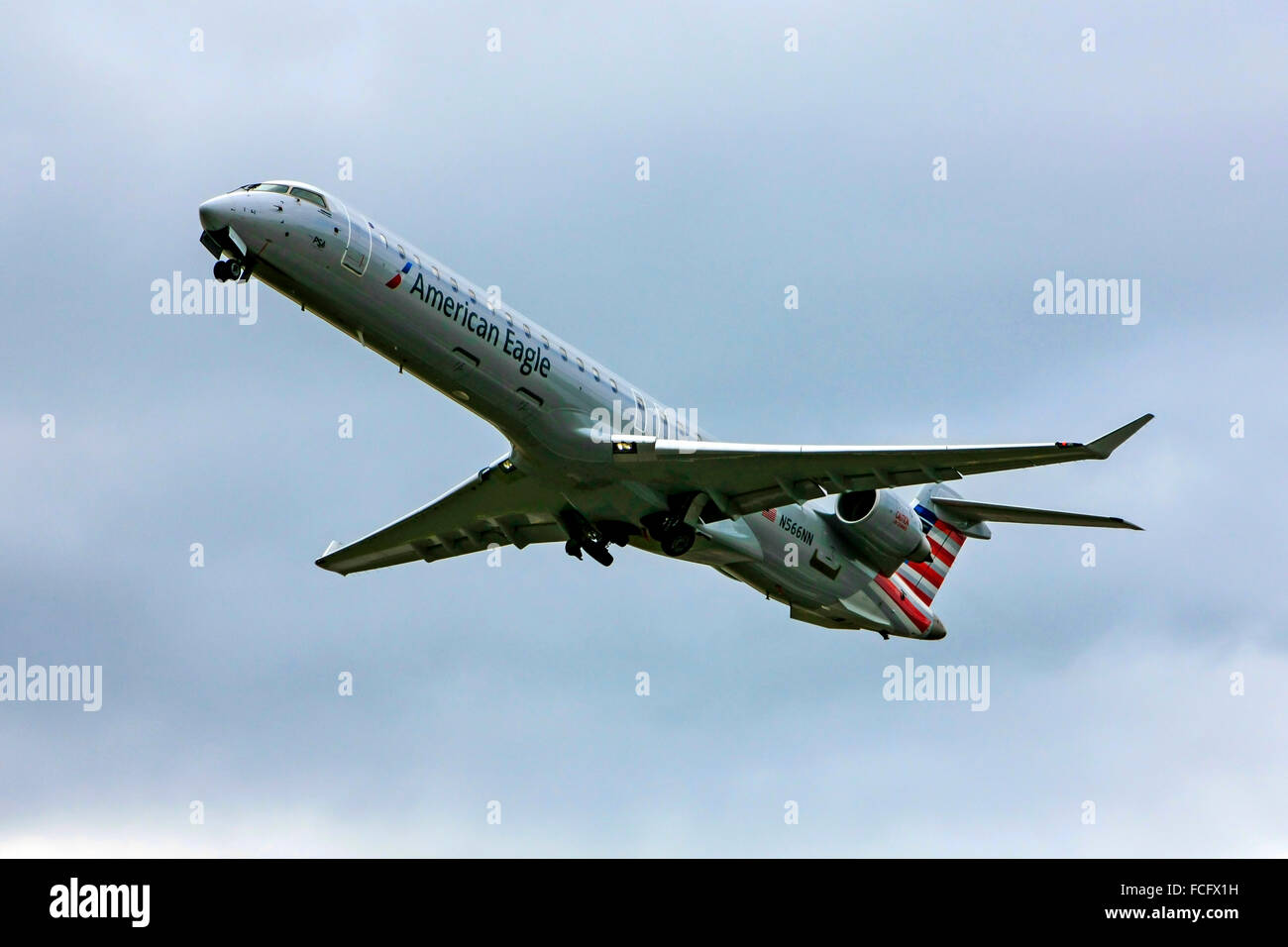 Canadair CL-600-2D24 commercial jet passenger plane of American Airlines departs Sarasota airport for CLT Charlotte - Stock Image