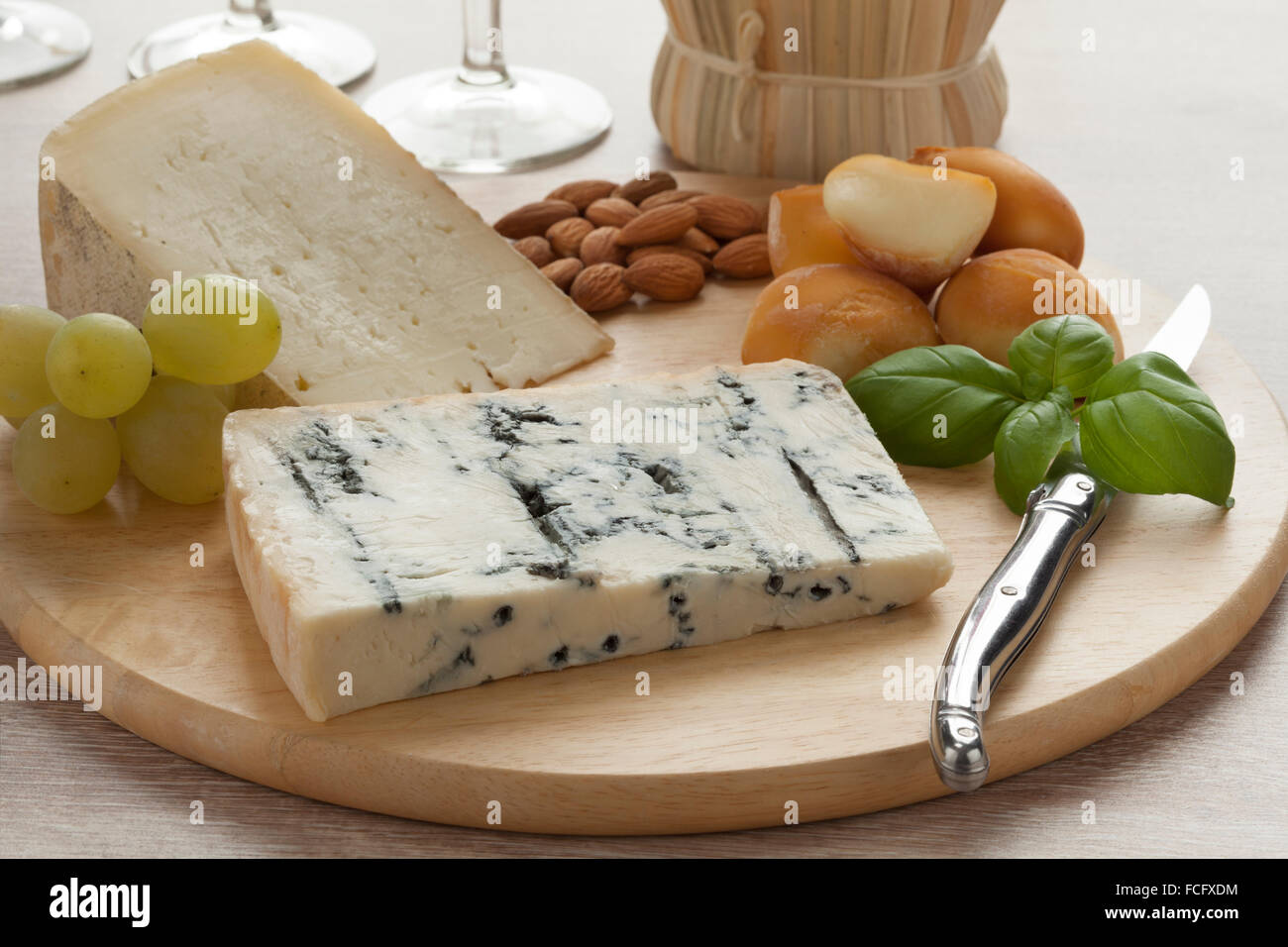 Italian cheese platter with smoked mozzarella, gorgonzola picante and toma piemontese - Stock Image