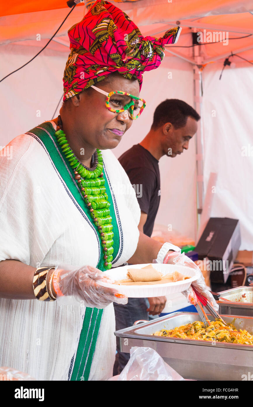 Woman serving food - Stock Image