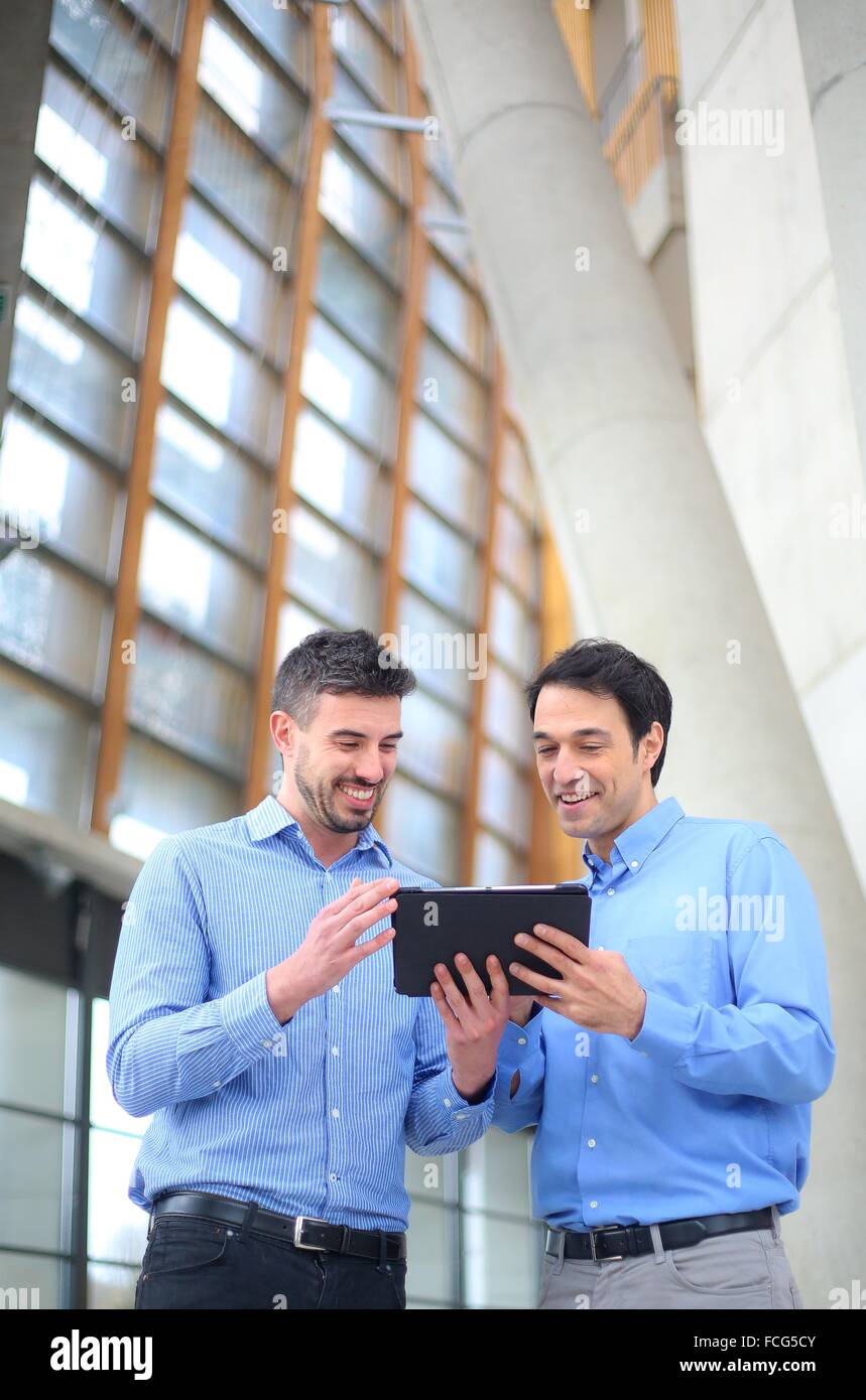 Two executives with digital tablet - Stock Image