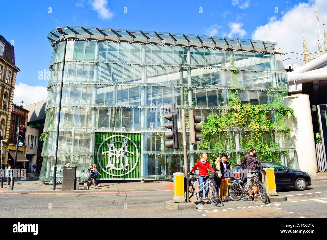 Borough Market facade, people waiting at a stoplight. London, England, United Kingdom. - Stock Image