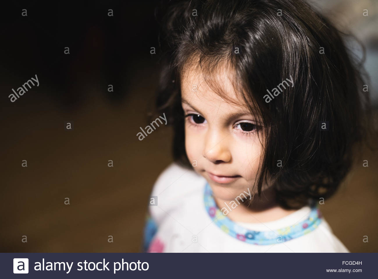 Portrait of little girl   dark hair - Stock Image