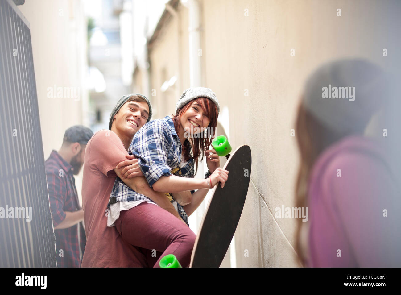 Friends   skateboard having fun in a passageway - Stock Image