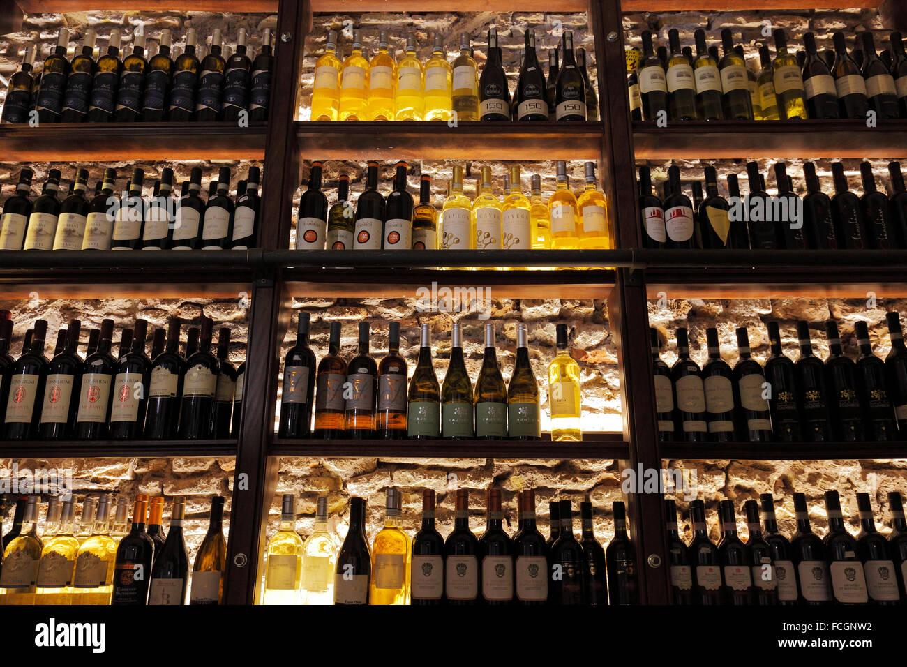 wine shelf in a deli shop in Rome - Stock Image