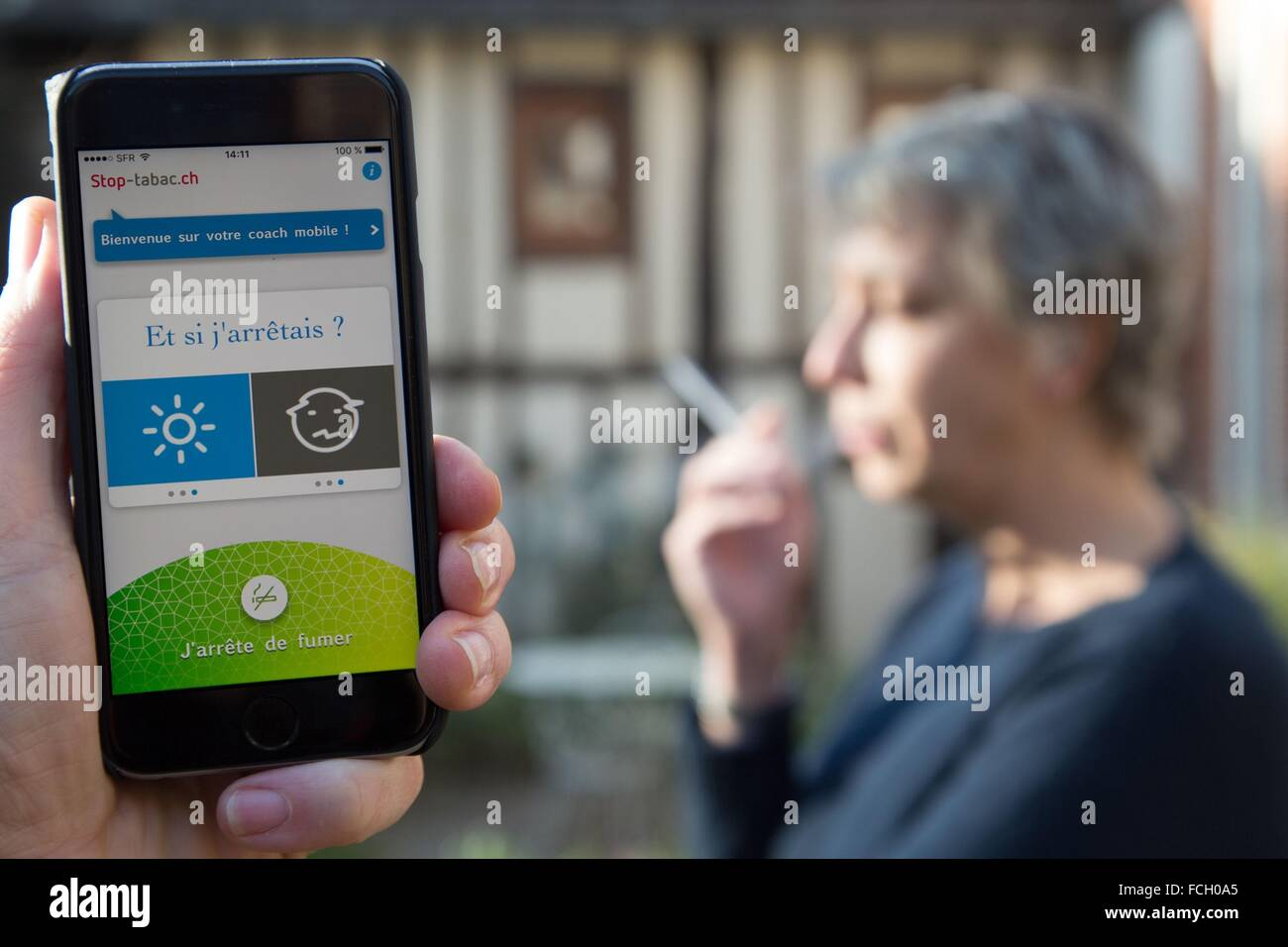 MOBILE APPLICATION FOR A CELL PHONE USER, SMOKER - Stock Image
