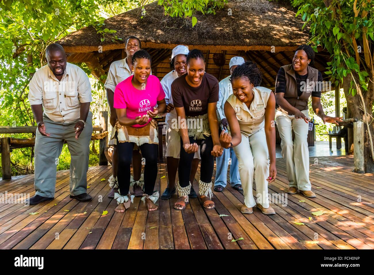 Staff members of the Lebala Safari Camp at the Kwando Concession do a traditional singing and dancing performance, Stock Photo