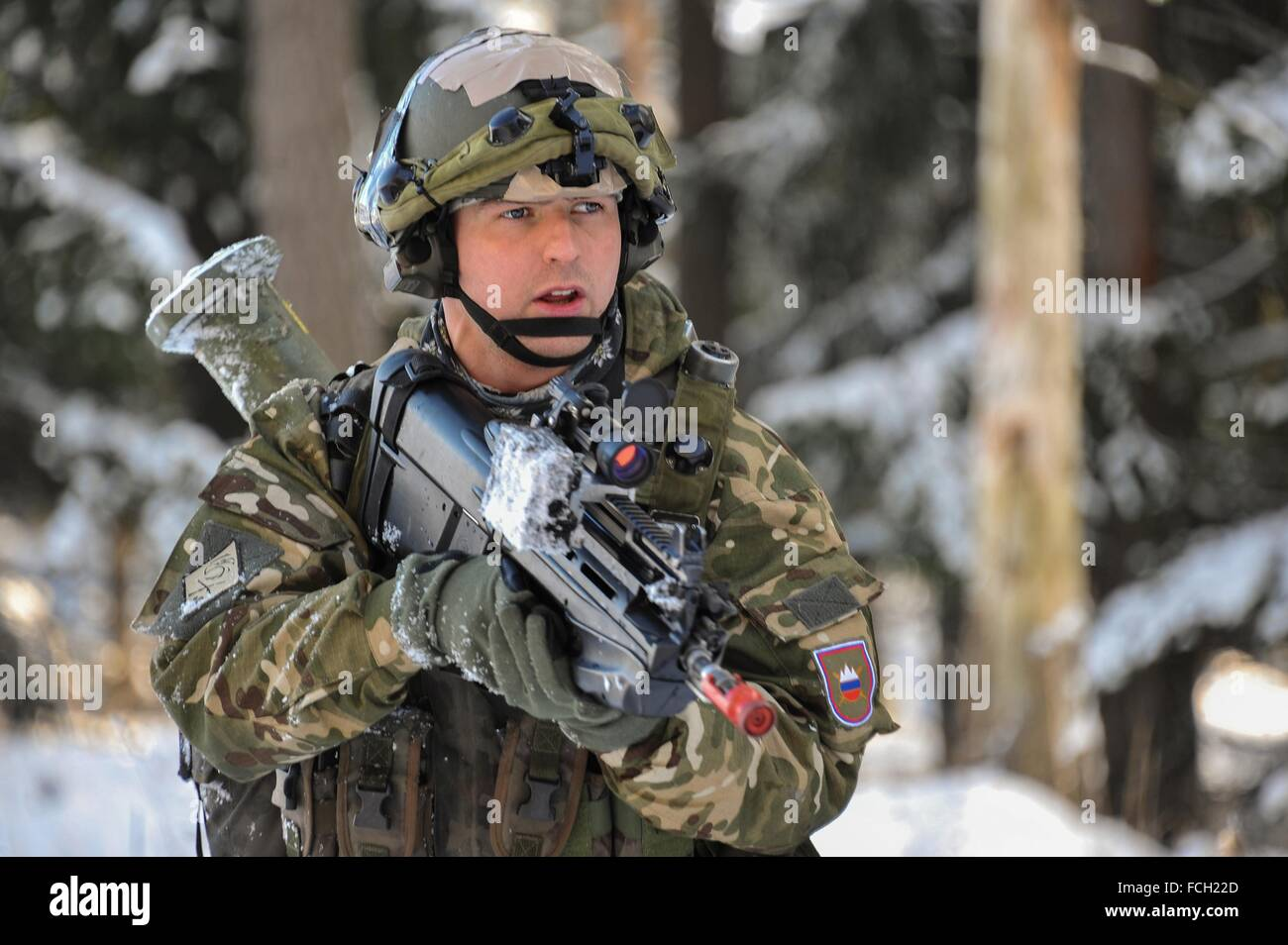 Hohenfels Army base, Germany. 21st January, 2016. A Slovenian soldier with the 3rd Company, 10th Regiment reacts - Stock Image