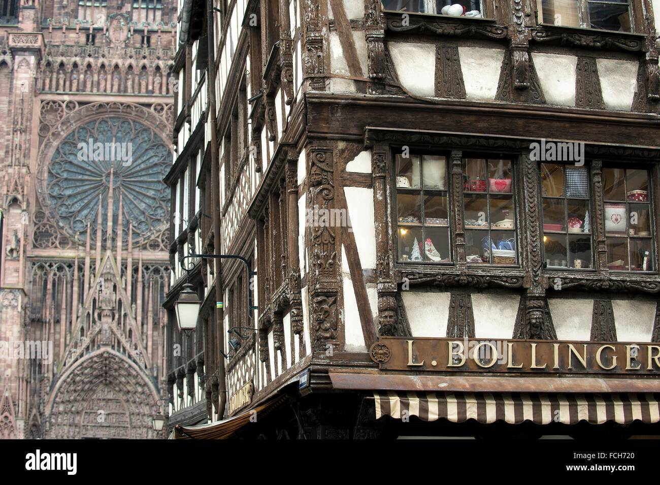 Strasbourg, frame house beside gothic cathedral, Alsace, France. - Stock Image