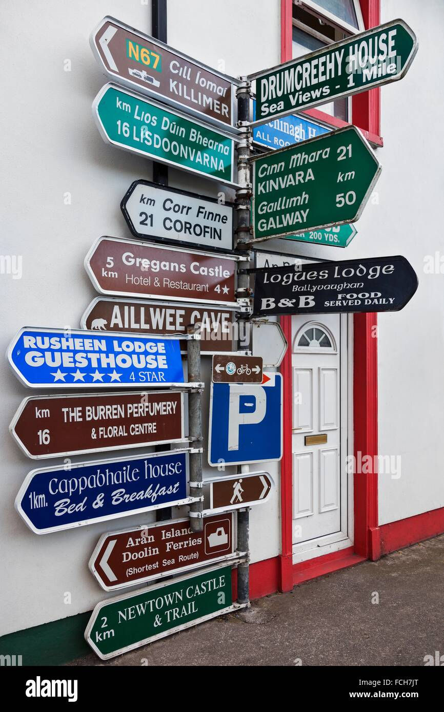 Directional signage at the crossroads in Ballyvaughan Village, Co. Clare, Ireland. - Stock Image