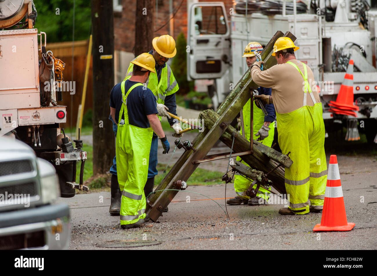 Workers replacing an electrical pole Stock Photo