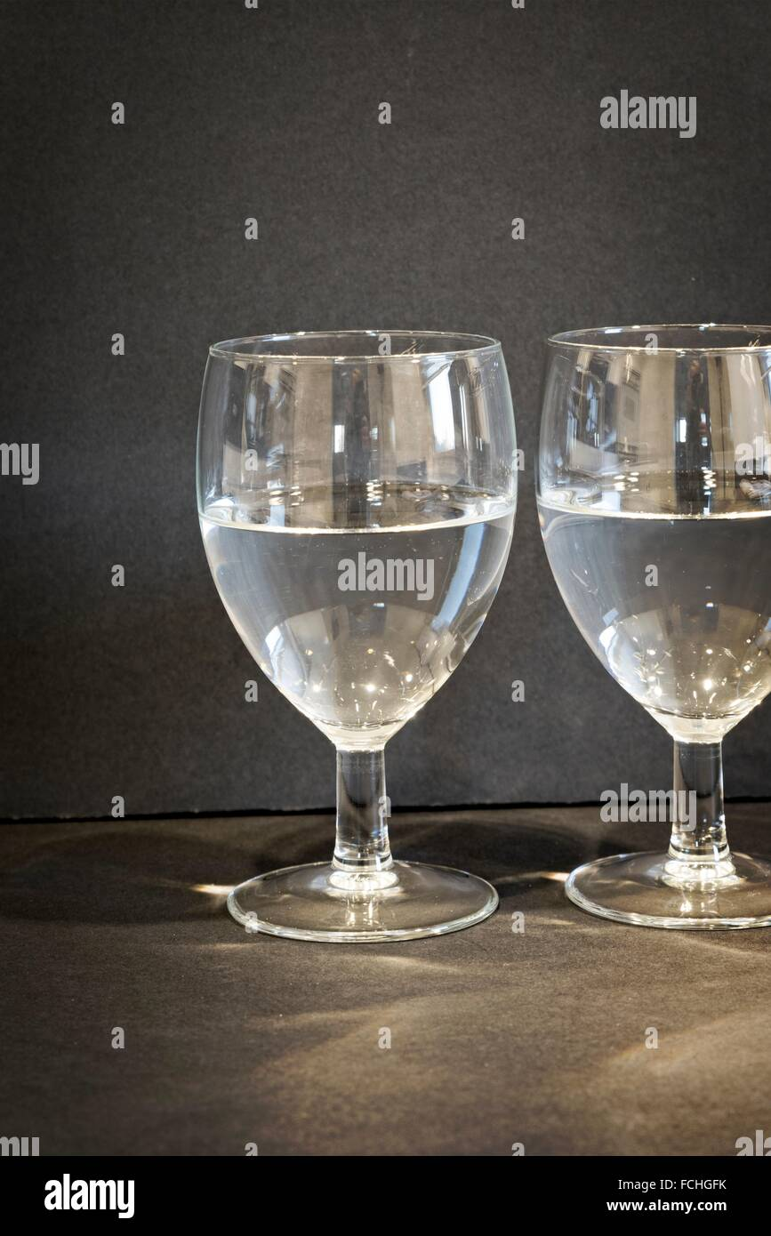 Two Glasses of Water, half full or half empty?. - Stock Image