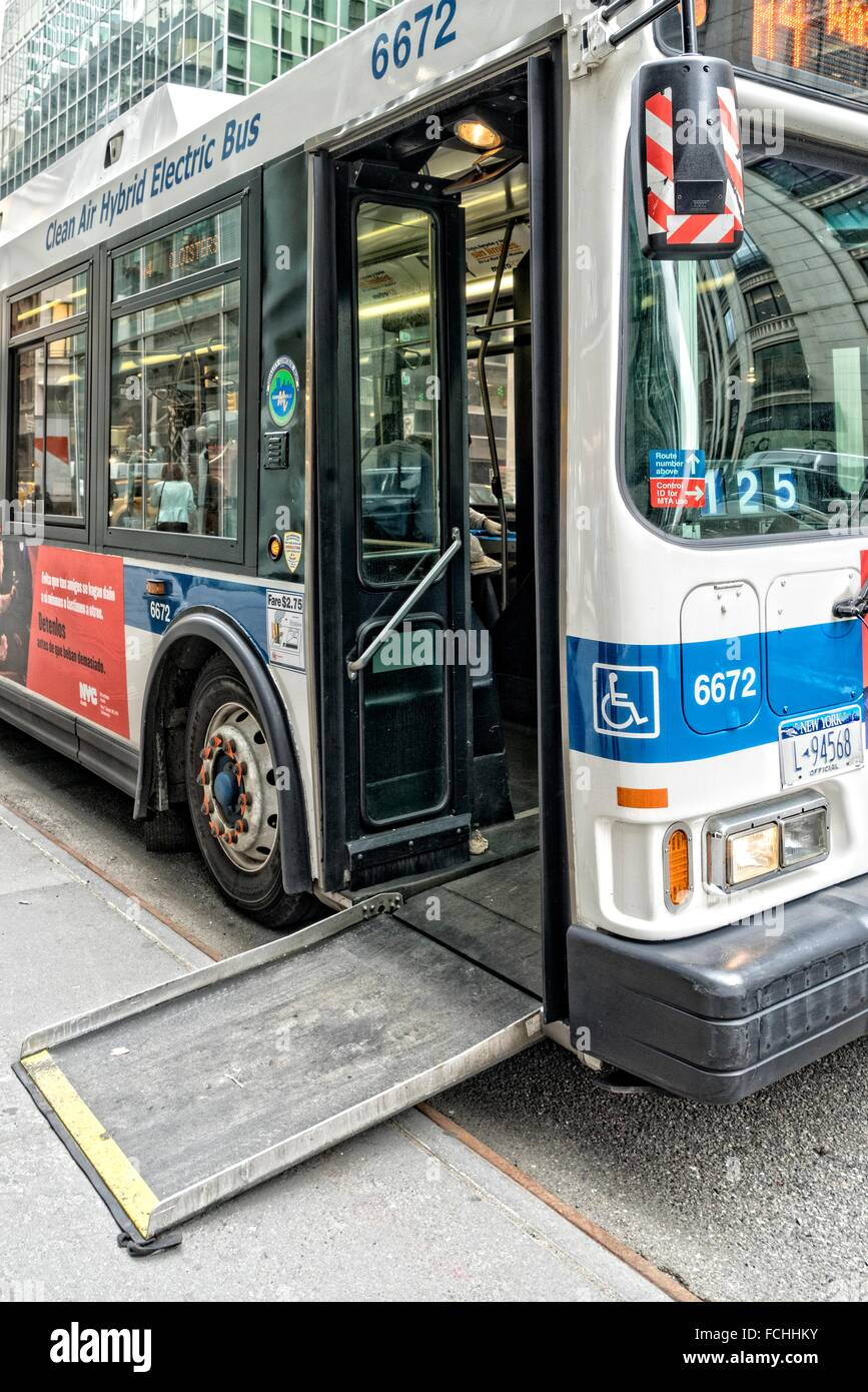 an m4 manhattan new york city bus parked at the curb to pick up and