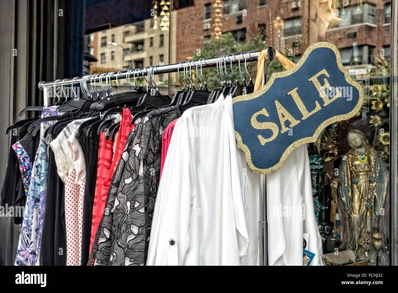 Sale Rack of Vintage Clothing Displayed on the Sidewalk outside of ...