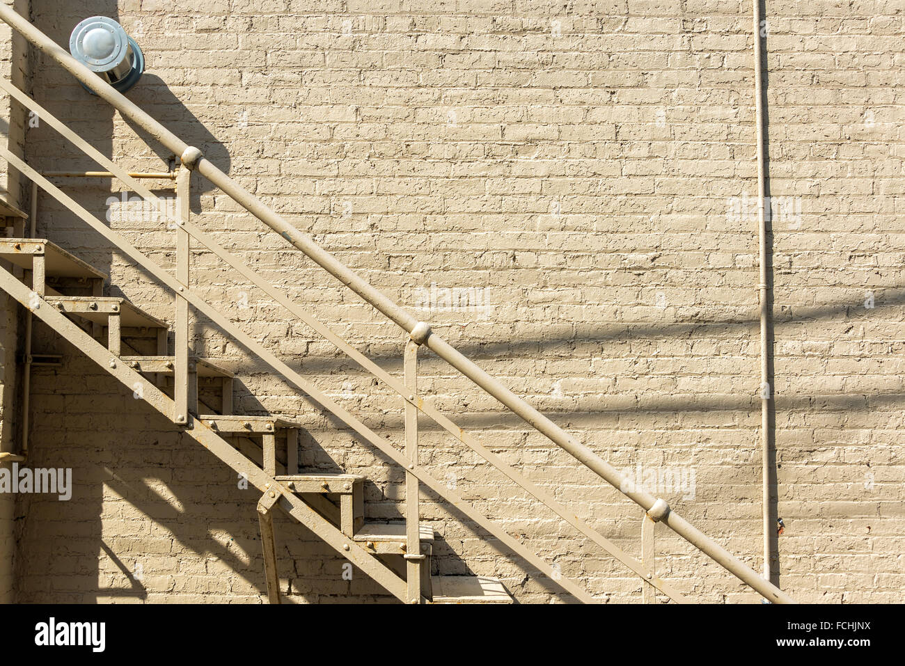 Staircase and brick wall in an alley in Wallace, Idaho - Stock Image