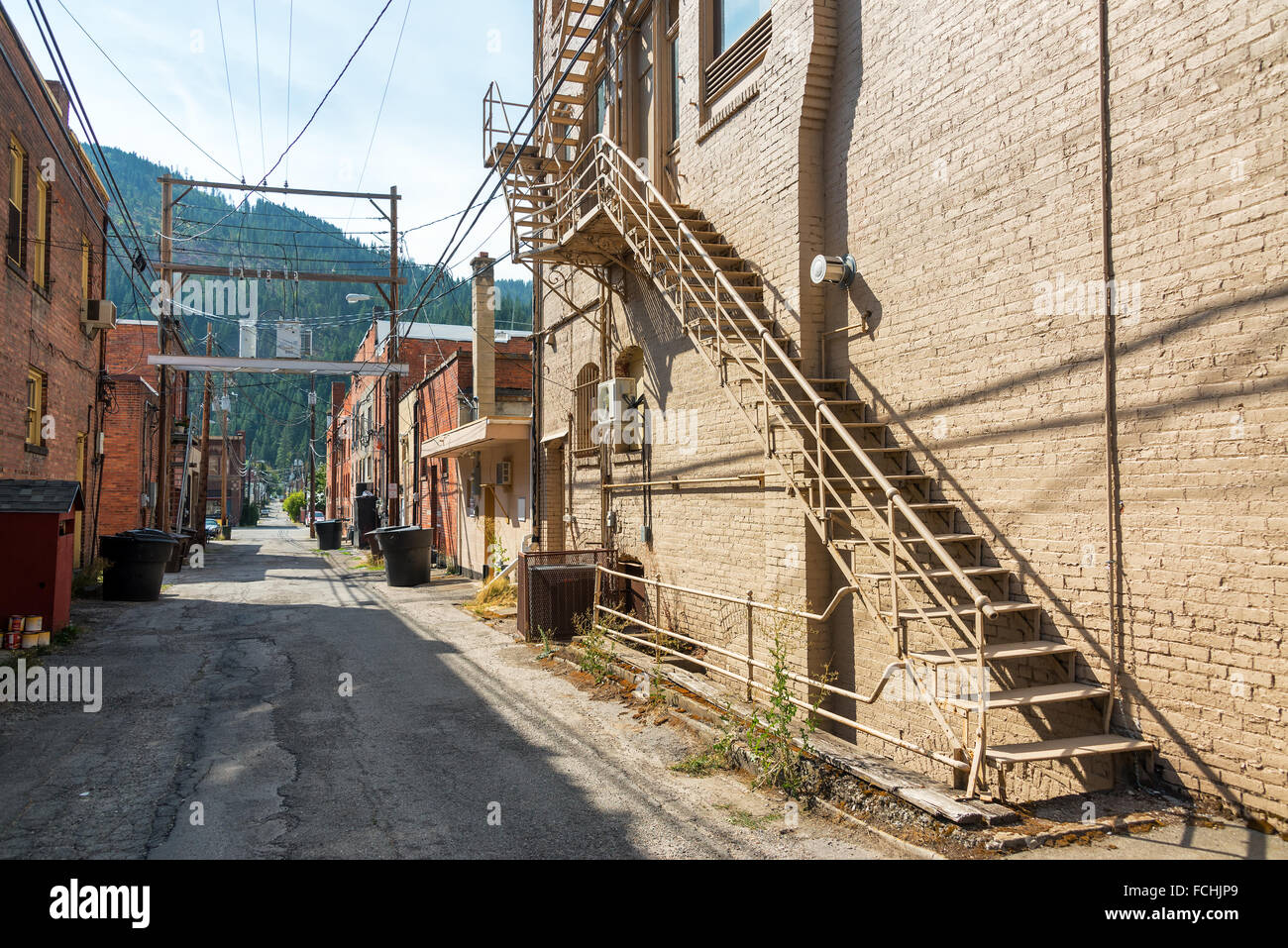Narrow alley in the historic mining town of Wallace, Idaho - Stock Image