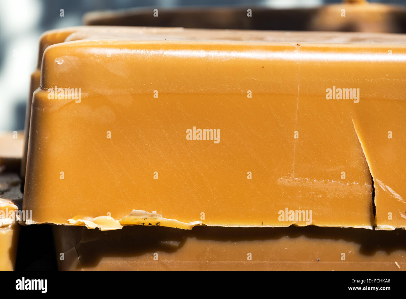Closeup view of a brick of beeswax in Buffalo, Wyoming - Stock Image