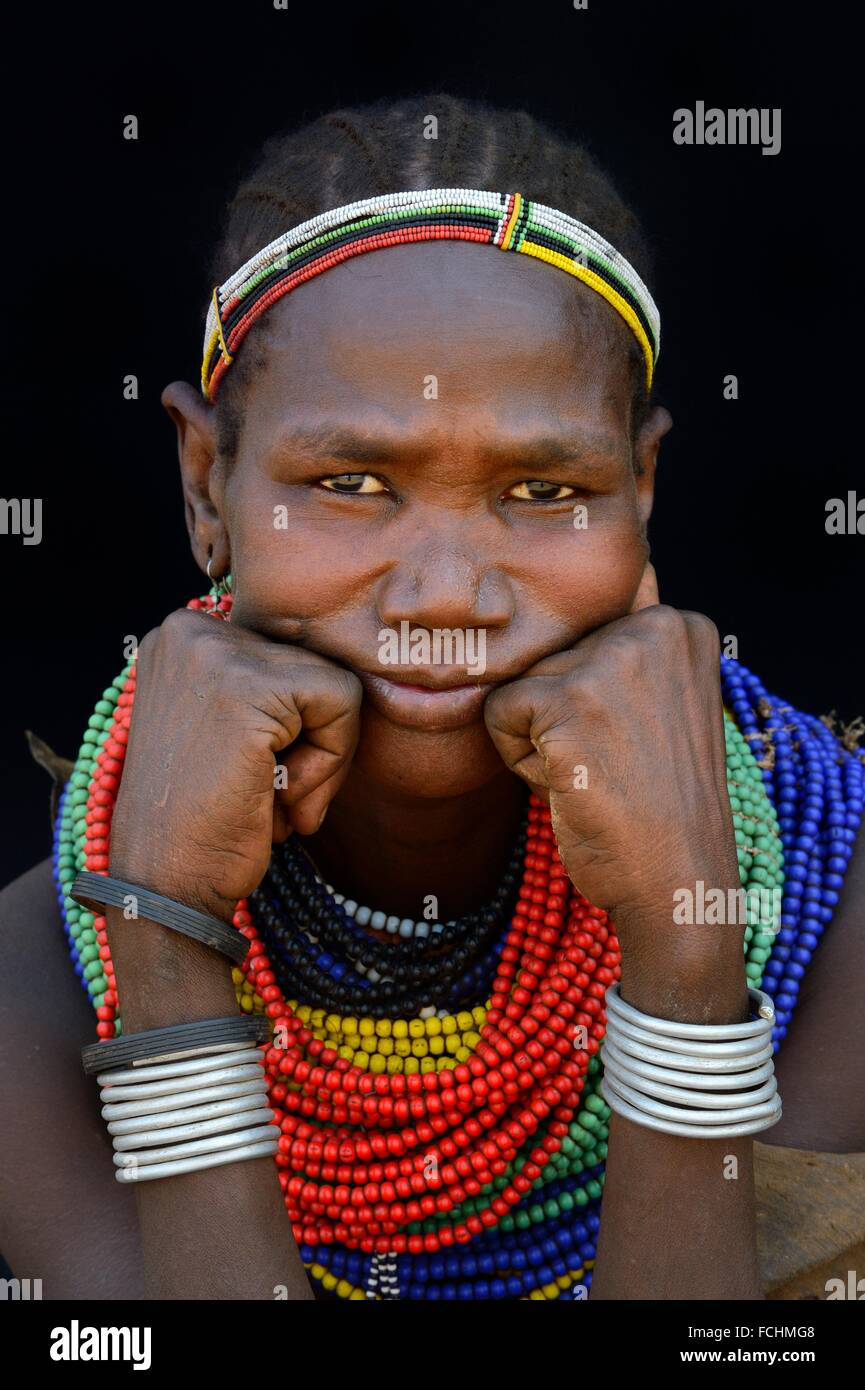 Woman of the Nyangatom tribe with traditional jewels, Omo Valley, Ethiopia, Africa. - Stock Image