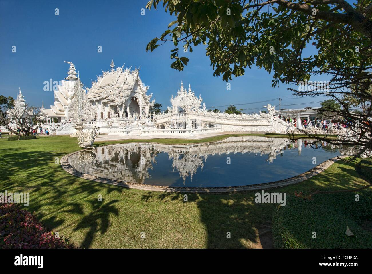 The gleaming white temple Wat Rong Khun in Chiang Rai, Thailand. - Stock Image